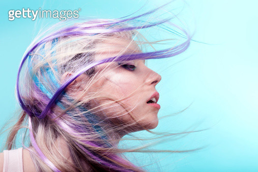 Lady with colorful hair flying over her face - gettyimageskorea