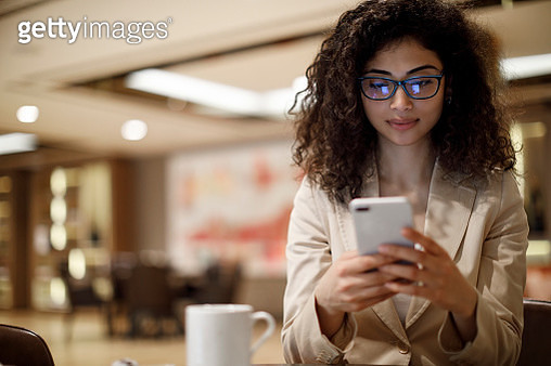 Businesswoman staying in touch with her clients on business trip - gettyimageskorea