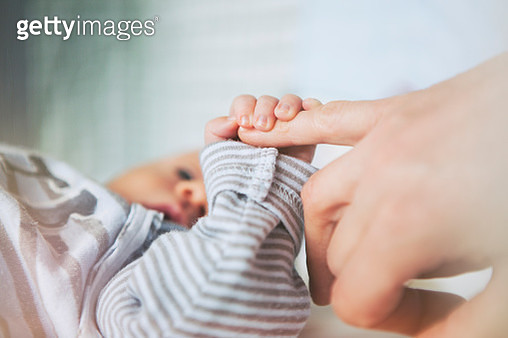 Mother holding her baby hand - gettyimageskorea