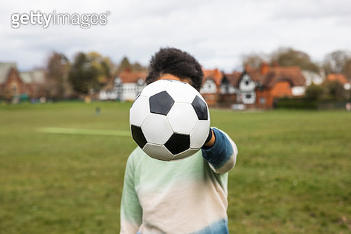 Unrecognisable Woman Holding a Football - gettyimageskorea