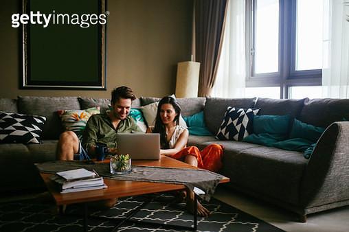 Young people working in apartment in Kuala Lumpur, Malaysia - gettyimageskorea