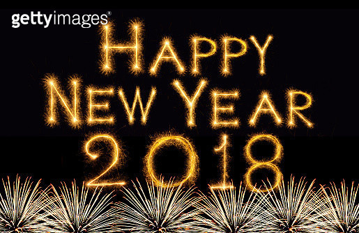 celebration and greeting cards concept, Happy new year 2018 written with Sparkle firework on fireworks with dark background - gettyimageskorea