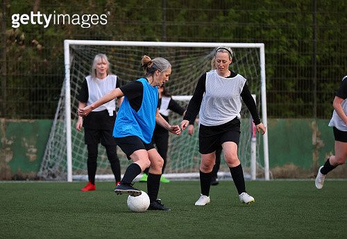 Women compete in a football match - gettyimageskorea