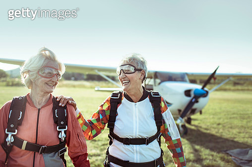 Close up of two senior friends after a successful skydive - gettyimageskorea