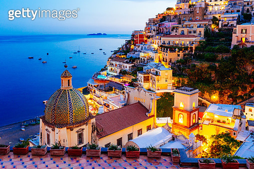 Positano, Amalfi Coast, Campania, Sorrento, Italy. View of the town and the seaside in a summer sunset - gettyimageskorea
