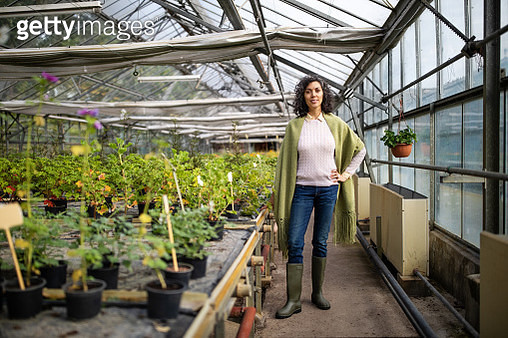 Successful mid adult greenhouse owner - gettyimageskorea