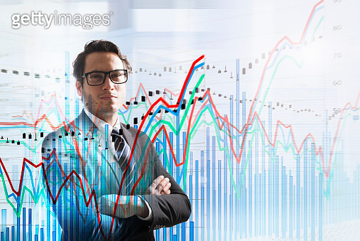 Conceptual image of businessman with graph data - gettyimageskorea