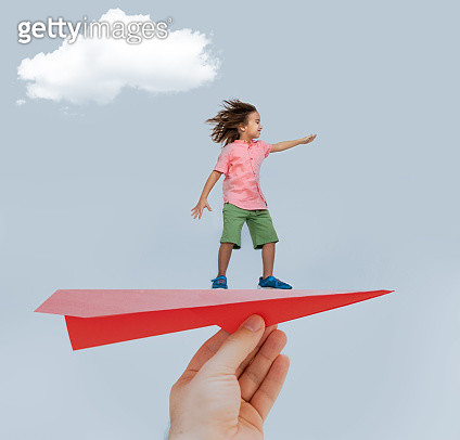 The boy is enjoying his flying on paper plane - gettyimageskorea