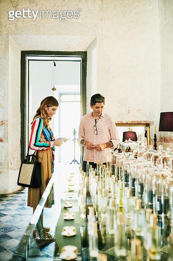 Couple sampling fragrances in perfumery - gettyimageskorea