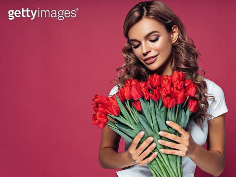 Beautiful woman with flowers - gettyimageskorea