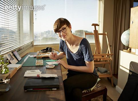 Portrait of female artist working at studio - gettyimageskorea