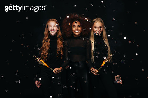 Three happy young girls celebrates New Year - gettyimageskorea