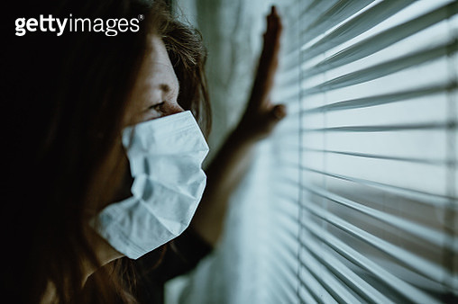 woman in isolation at home for virus outbreak - gettyimageskorea