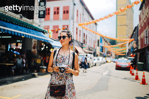 fashionable solo traveler woman walking the streets of Singapore Chinatown - gettyimageskorea