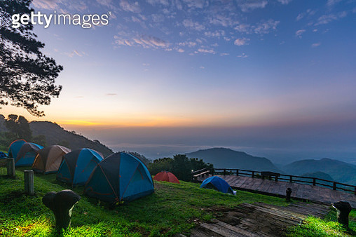 Tents On Field Against Sky During Sunset - gettyimageskorea