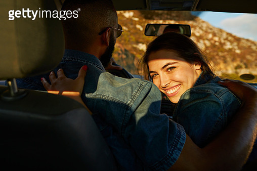 Woman hugging boyfriend while driving car - gettyimageskorea