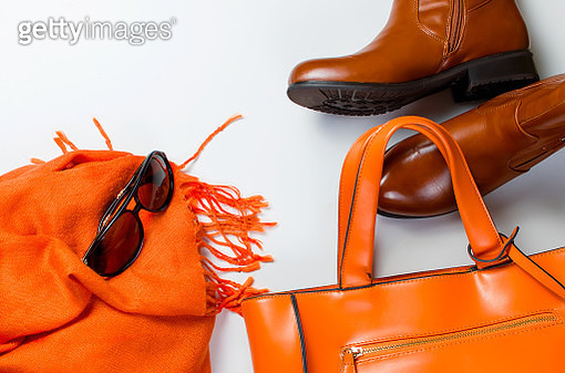 Directly Above Shot Of Orange Purse By Boots Over White Background - gettyimageskorea