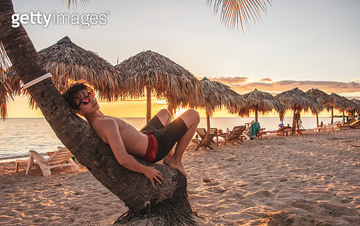 Teenager Chill Out for Lazy Evening,  Playa Ancon,  Trinidad, Cuba - gettyimageskorea