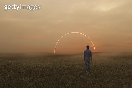 Sleepwalker in fantasy meadow walking into mysterious passage - gettyimageskorea