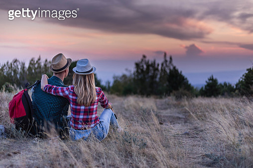 American couple looking sunset in nature. Copy space. - gettyimageskorea