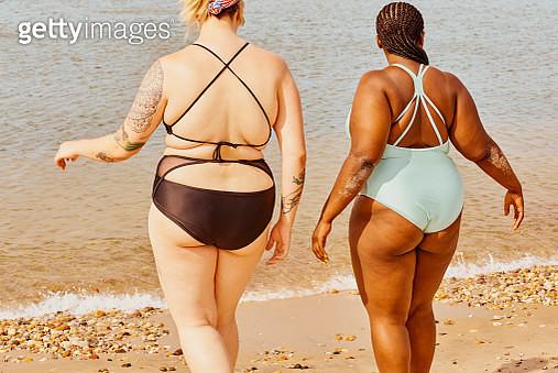 Two Young Women Walking - gettyimageskorea