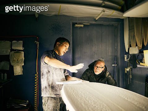 A senior male is shaping a surfboard - gettyimageskorea