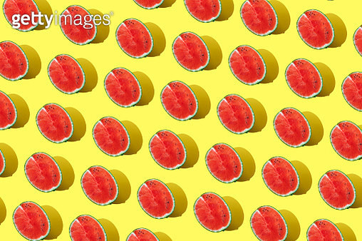 Repeated watermelon on the yellow background - gettyimageskorea