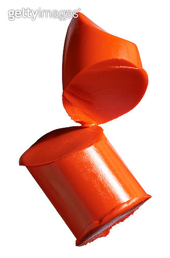 A close-up image of a sample of orange lipstick - gettyimageskorea
