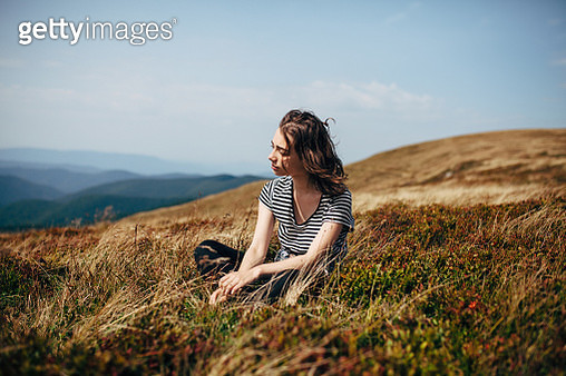 Woman in mountains - gettyimageskorea