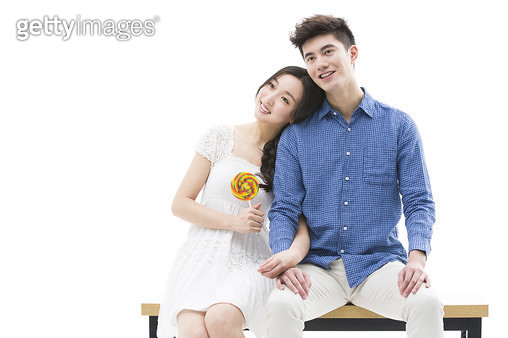 Happy young couple and lollipop - gettyimageskorea