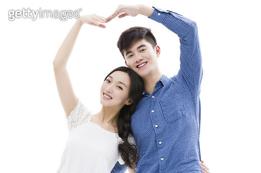 Young couple making heart shape with their arms - gettyimageskorea