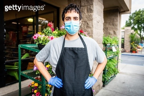 Hardware store and plant nursery worker posing with a protective mask - gettyimageskorea