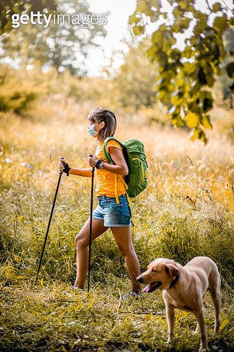 Young woman hiking during the COVID-19 pandemic - gettyimageskorea