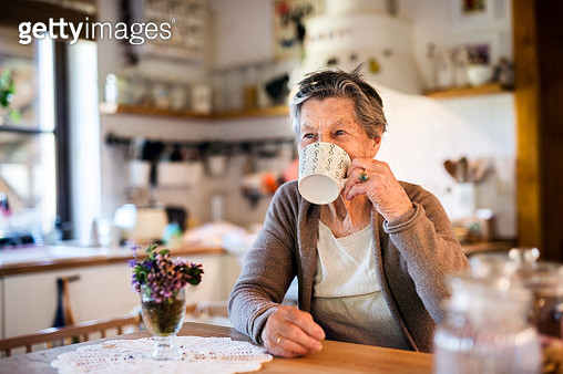 Grandmother at home drinking tea. - gettyimageskorea