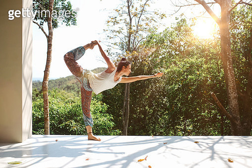 Young woman practicing Natarajasana  Lord of the dance pose in Thailand - gettyimageskorea
