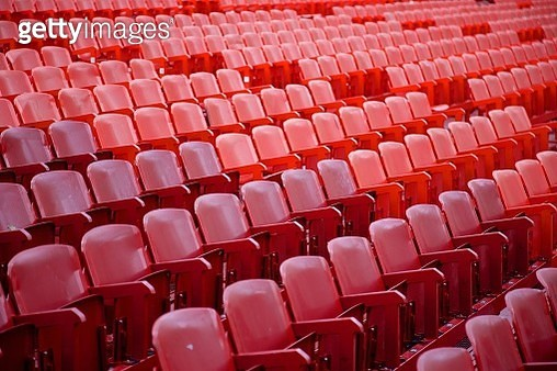 Red seats without people at arena / stadium - gettyimageskorea