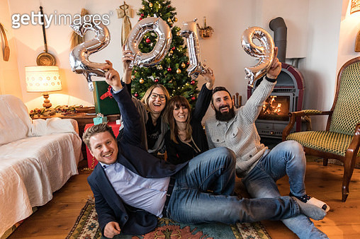 Happy family celebrating New Year at home - gettyimageskorea