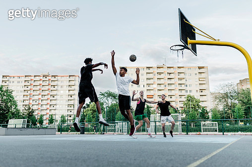 Friends playing Basketball - gettyimageskorea