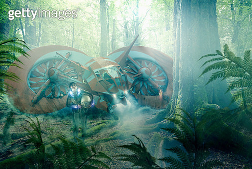 Asian woman and stranded spaceship in jungle - gettyimageskorea