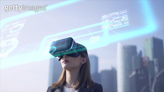 Future is now. Woman using virtual reality device while traveling in Singapore . - gettyimageskorea