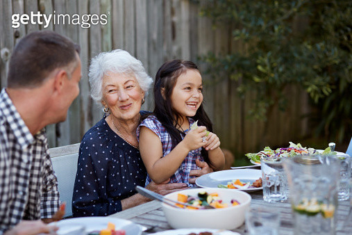 3 generations at outside dinner - gettyimageskorea