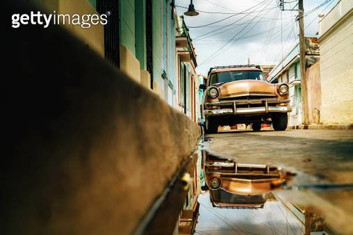 Old American car on street with water reflections, Havana, Cuba - gettyimageskorea