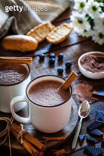 Two homemade hot chocolate mugs on rustic wooden table - gettyimageskorea