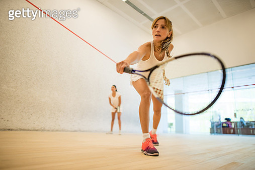 Young beautiful women playing squash - gettyimageskorea