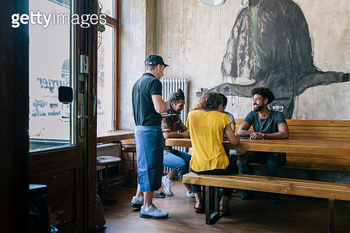 Waiter Taking Orders From Customers - gettyimageskorea