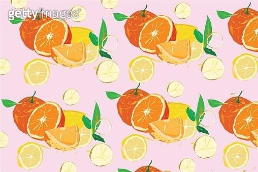 Fresh oranges cut in half on a pastel pink background - gettyimageskorea
