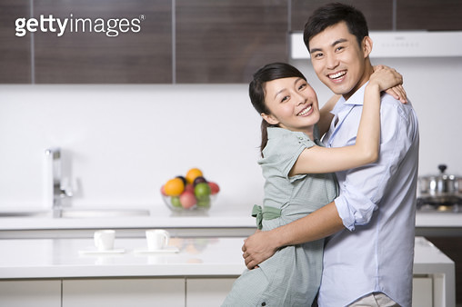 Portrait of a couple in the kitchen - gettyimageskorea