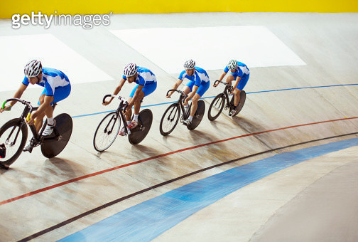 Track cycling team riding in velodrome - gettyimageskorea