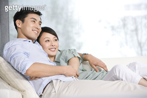 Portrait of a couple relaxing on the couch - gettyimageskorea