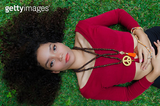 Beautiful young woman lying in the grass - gettyimageskorea
